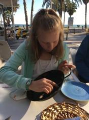 Hadley scraping the Paella pan